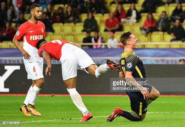 Leipzig's Austrian midfielder Marcel Sabitzer reacts as he receives a kick on the shoulder by Monaco's Colombian forward Radamel Falcao during the...