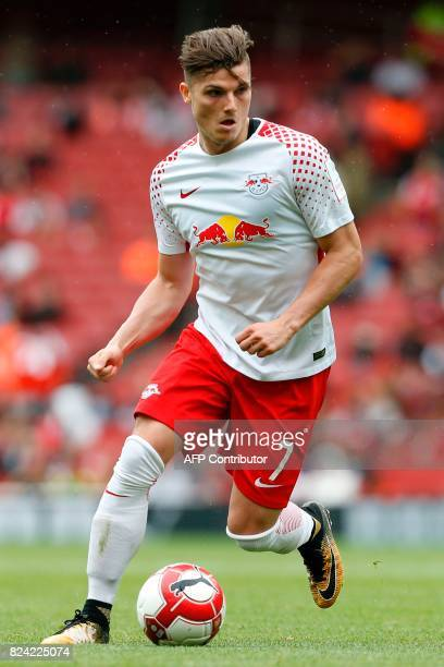 Leipzig's Austrian midfielder Marcel Sabitzer runs with the ball during the preseason friendly football match between RB Leipzig and Sevilla at The...