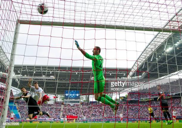 Leipzig's Austrian midfielder Marcel Sabitzer scores the 10 against Bayern Munich's goalkeeper Tom Starke during the German first division Bundesliga...