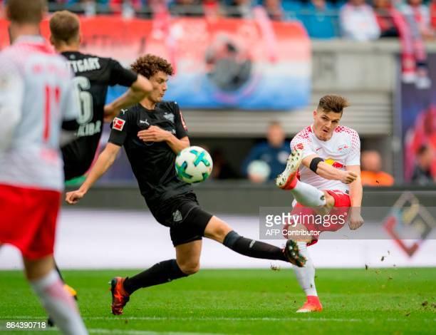 Leipzig's Austrian midfielder Marcel Sabitzer scores the opening goal next to Stuttgart's French defender Benjamin Pavard during the German first...