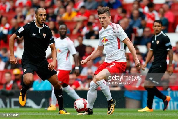 Leipzig's Austrian midfielder Marcel Sabitzer takes on Sevilla's Argentinian midfielder Guido Pizarro during the preseason friendly football match...
