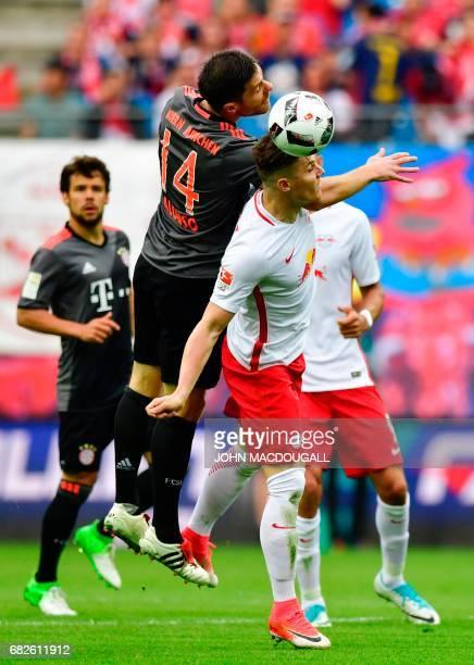 Leipzig's Austrian midfielder Marcel Sabitzer vies with Bayern Munich's Spanish midfielder Xabi Alonso during the German first division Bundesliga...