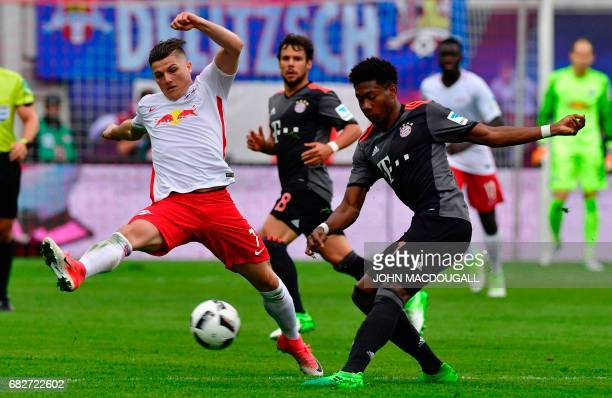 Leipzig's Austrian midfielder Marcel Sabitzer vies with Bayern Munich's Austrian defender David Alaba during the Bundesliga match RB Leipzig vs...