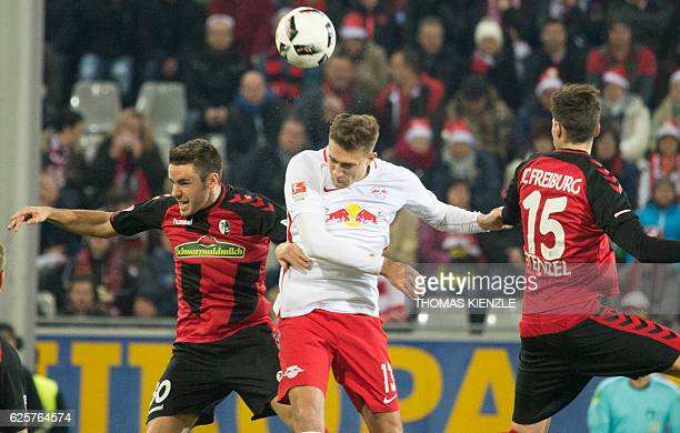 Leipzig's Austrian midfielder Stefan Ilsanker and Freiburg's defender Christian Guenter and defender Pascal Stenzel vie for the ball during the...