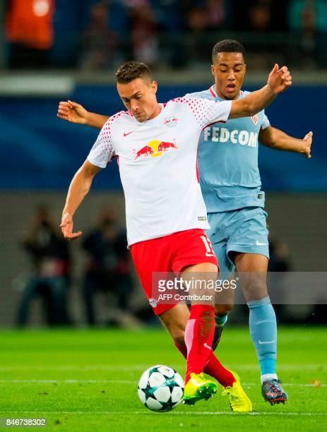 Leipzig's Austrian midfielder Stefan Ilsanker and Monaco's Belgian midfielder Youri Tielemans vie for the ball during the UEFA Champions League group...