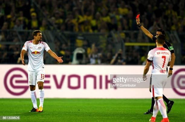 Leipzig's Austrian midfielder Stefan Ilsanker reacts after referee Deniz Aytekin shew him the red card during the German First division Bundesliga...