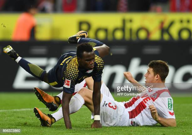 Leipzig´s Belgian midfielder Massimo Bruno and Cologne's defender Dominique Heintz vie for the ball during the German First division Bundesliga...