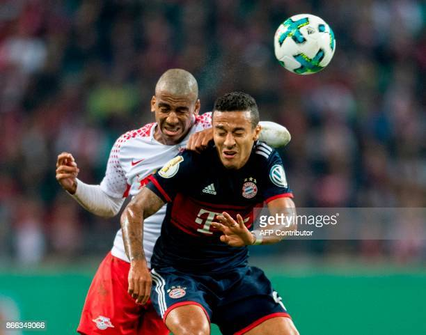 Leipzig's Brazilian defender Bernardo and Bayern Munich's Spanish midfielder Thiago Alcantara vie for the ball during the German Cup football match...