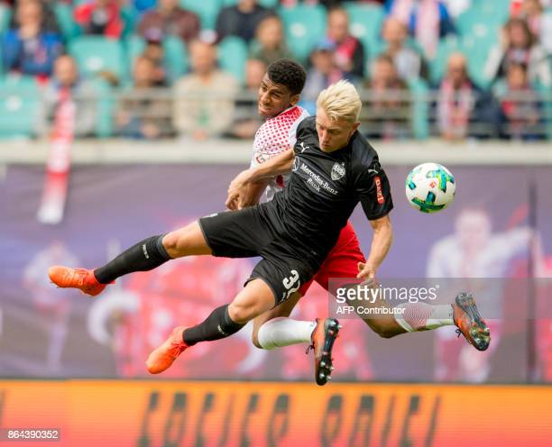 TOPSHOT Leipzig's Brazilian defender Bernardo and Stuttgart's German defender Andreas Beck vie for the ball during the German first division...
