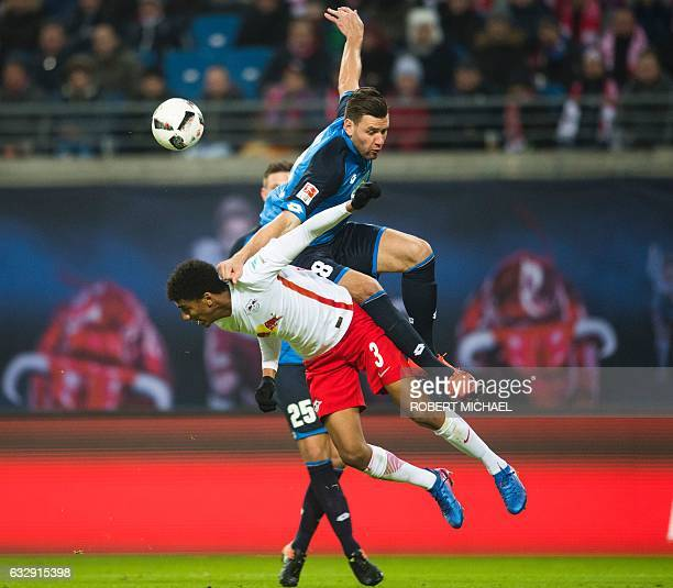 Leipzig's Brazilian defender Bernardo Fernandes da Silva Junior and Hoffenheim's Hungarian forward Adam Szalai vie for the ball during the German...