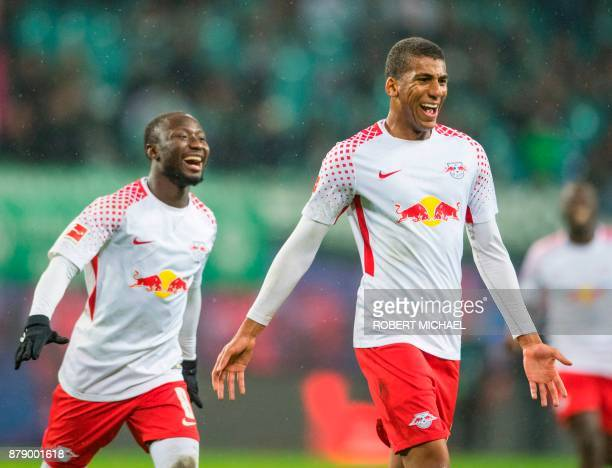 Leipzig´s Brazilian defender Bernardo Fernandes da Silva Junior celebrates scoring the second goal with Guinean midfielder Naby Deco Keita during the...