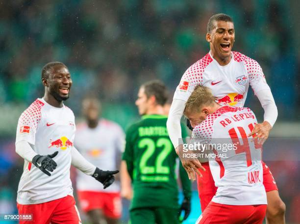 Leipzig´s Brazilian defender Bernardo Fernandes da Silva Junior celebrates scoring the second goal with Guinean midfielder Naby Deco Keita and...