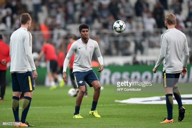 RB Leipzig's Brazilian midfielder Bernardo Fernandes da Silva Junior warms up with teammates before the start of the UEFA Champions League group G...