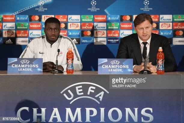 Leipzig's coach Ralph Hasenhuttl speaks next to French defender Dayot Upamecano during a press conference on the eve of an UEFA Champions League...