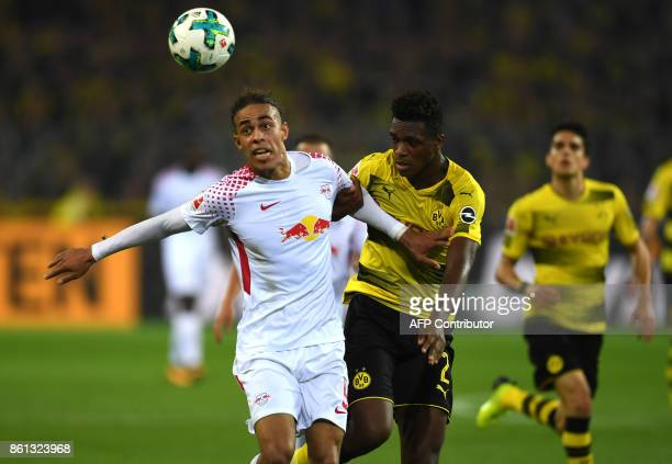 Leipzig's Danish forward Yussuf Poulsen and Dortmund's French defender DanAxel Zagadou vie for the ball during the German first division Bundesliga...