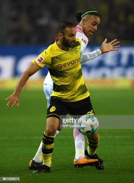 Leipzig's Danish forward Yussuf Poulsen and Dortmund's Turkish defender Omer Toprak vie for the ball during the German first division Bundesliga...