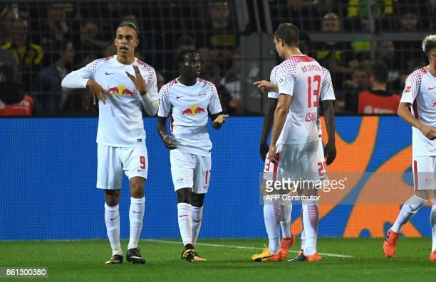 Leipzig's Danish forward Yussuf Poulsen celebrates after scoringduring the German first division Bundesliga football match Borussia Dortmund vs RB...