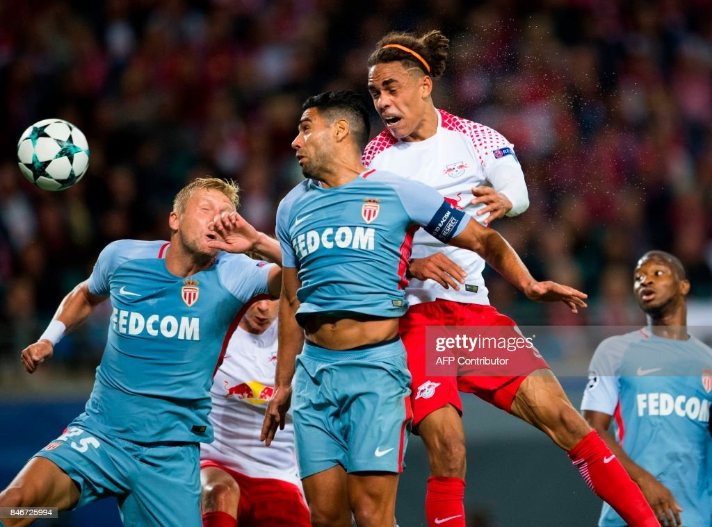 Leipzig's Danish forward Yussuf Poulsen (R), Monaco's Columbian forward Radamel Falcao (C) and Monaco's Polish defender Kamil Glik vie for the ball during the UEFA Champions League group G football match RB Leipzig v AS Monaco in Leipzig, eastern Germany on September 13, 2017. /