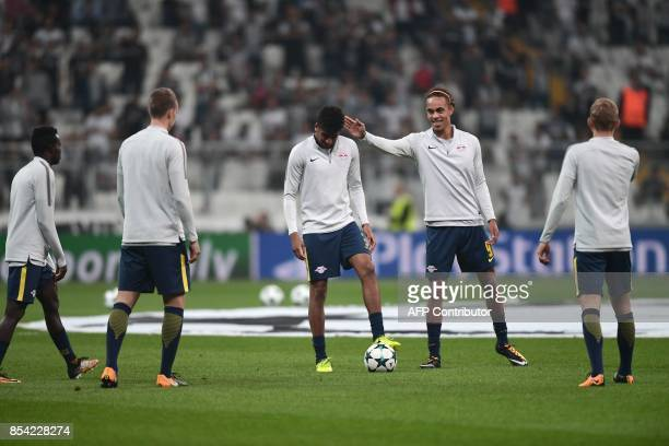 RB Leipzig's Danish forward Yussuf Poulsen touches the head of RB Leipzig's Brazilian midfielder Bernardo Fernandes da Silva Junior as they warm up...