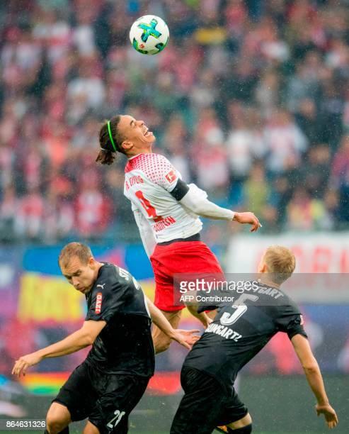 Leipzig's Danish forward Yussuf Poulsen vies for the ball with Stuttgart's German defender Holger Badstuber and Stuttgart's German defender Timo...