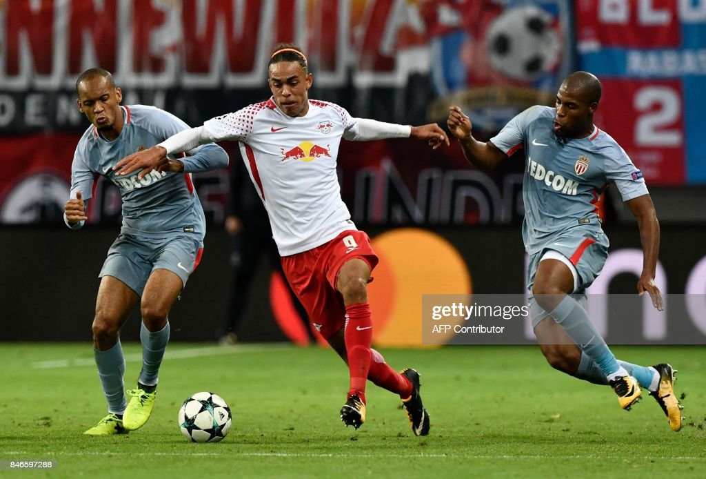Leipzig's Danish forward Yussuf Poulsen (C) vies for the ball with Monaco's Brazilian defender Fabinho (L) and Monaco's French defender Djibril Sidibe (R) during the UEFA Champions League group G football match RB Leipzig v AS Monaco in Leipzig, eastern Germany on September 13, 2017. / AFP PHOTO / John MACDOUGALL