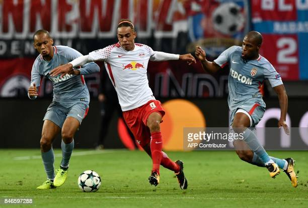 Leipzig's Danish forward Yussuf Poulsen vies for the ball with Monaco's Brazilian defender Fabinho and Monaco's French defender Djibril Sidibe during...