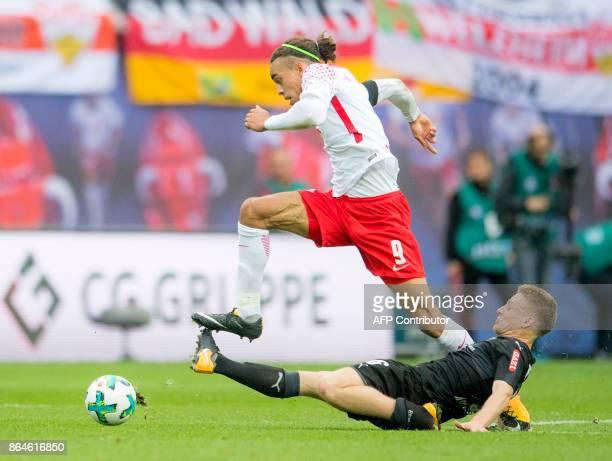 Leipzig's Danish forward Yussuf Poulsen vies with Stuttgart's Argentinian midfielder Santiago Ascacibar during the German first division Bundesliga...