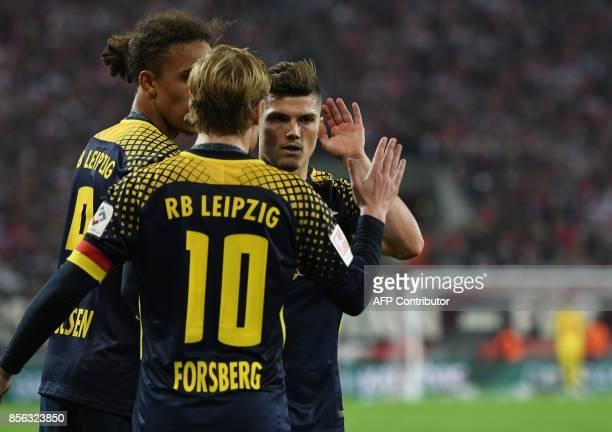 Leipzig´s Danish striker Yussuf Poulsen Leipzig´s Austrian midfielder Marcel Sabitzer and Leipzig´s Swedish midfielder Emil Forsberg celebrate after...