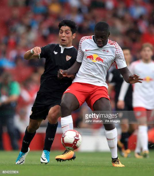 RB Leipzig's Dayot Upamecano and Sevilla's Boria Lasso battle for the ball during the Emirates Cup match at the Emirates Stadium London
