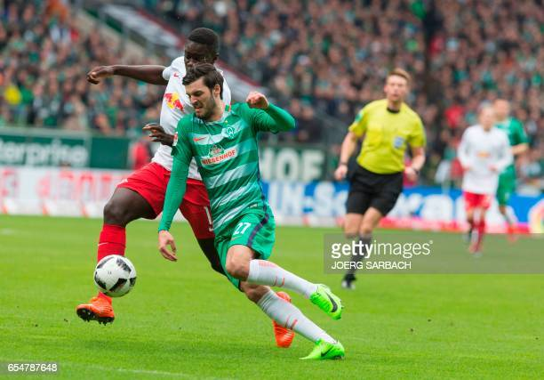 Leipzigs defender Dayot Upamecano and Bremen's Austrian midfielder Florian Grillitsch vie for the ball during the German First division Bundesliga...
