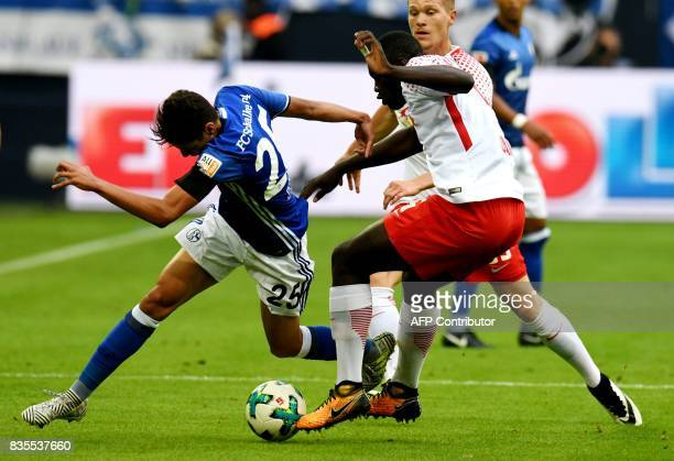 Leipzig´s defender Dayot Upamecano and Schalke's striker Armine Harit vie for the ball during the German First division Bundesliga football match FC...