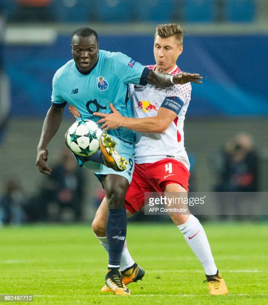 Leipzig´s defender Willi Orban and Porto´s Cameroonian forward Vincent Aboubakar vie for the ball during the UEFA Champions League group G football...