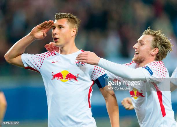 Leipzig´s defender Willi Orban celebrates scoring the opening goal with his teammate Swedish forward Emil Forsberg during the UEFA Champions League...