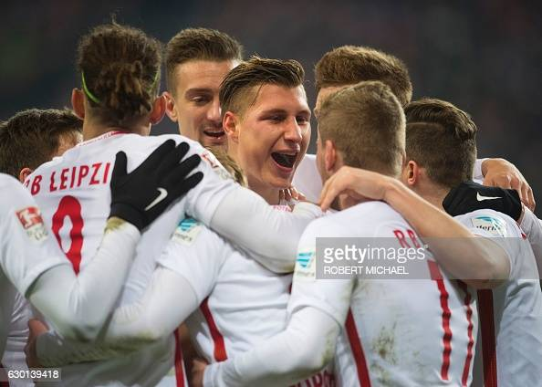 Leipzig´s defender Willi Orban celebrates with his teamate after scoring during the German first division Bundesliga football match between RB...