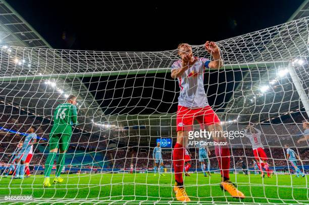 Leipzig´s defender Willi Orban reacts after they conceded the equalizer during the UEFA Champions League group G football match RB Leipzig v AS...