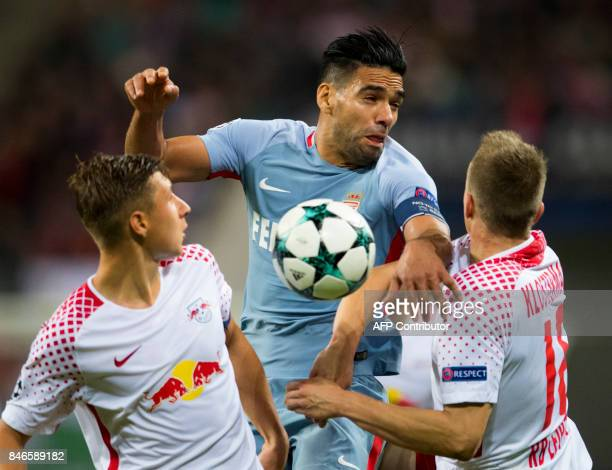 Leipzig´s defenders Willi Orban and Lukas Klostermann vie for the ball with Monaco's Colombian forward Radamel Falcao during the UEFA Champions...