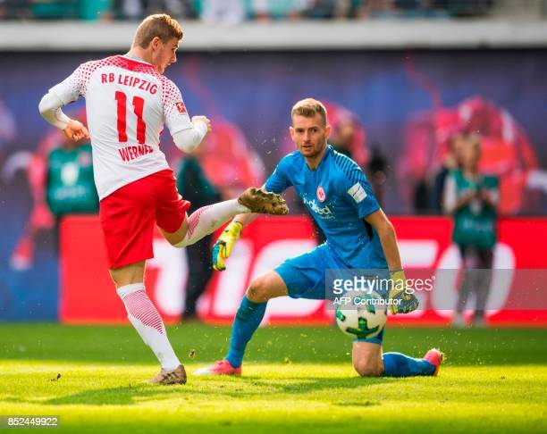 Leipzig´s forward Timo Werner and Frankfurt´s Finnish goalkeeper Lukas Hradecky vie for the ball during the German first division Bundesliga football...