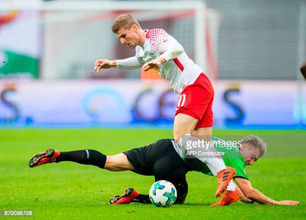 Leipzig´s forward Timo Werner and Hannover´s midfielder Felix Klaus vie for the ball during the German first division Bundesliga football match...