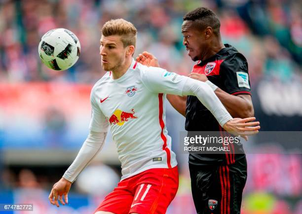 Leipzig's forward Timo Werner and Ingolstadt's Brazilian midfielder Roger de Oliveira Bernardo vie for the ball during the German first division...