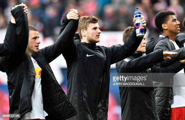 Leipzig's forward Timo Werner and Leipzig's midfielder Diego Demme celebrate after the German First division Bundesliga football match between RB...
