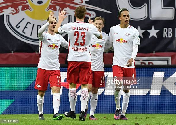 Leipzig's forward Timo Werner celebrates with Leipzig's defender Marcel Halstenberg Leipzig's Swedish midfielder Emil Forsberg and Leipzig's Danish...