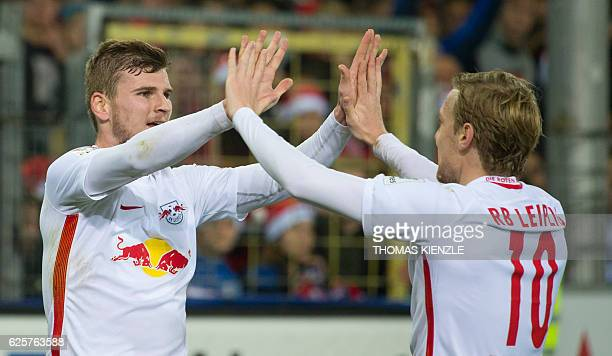 Leipzig's forward Timo Werner celebrates with teammate Swedish forward Emil Forsberg after he scored during the German first division Bundesliga...