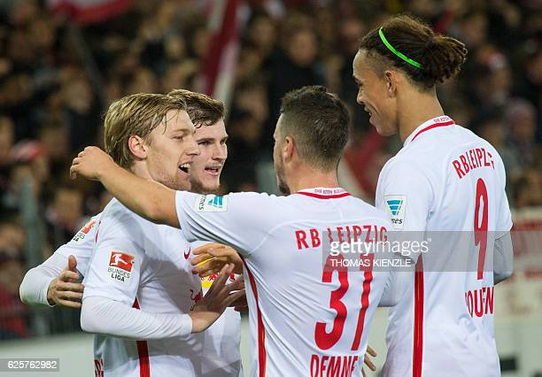 Leipzig's forward Timo Werner cleberates with teammates after scoring during the German first division Bundesliga football match between SC Freiburg...