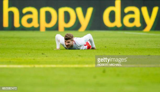Leipzig's forward Timo Werner lays on the pitch during the German First division Bundesliga football match of RB Leipzig vs VfL Wolfsburg in Leipzig...