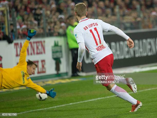 Leipzig's forward Timo Werner scores his second goal past Freiburg's goalkeeper Alexander Schwolow during the German first division Bundesliga...