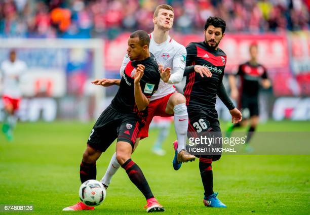 Leipzig's forward Timo Werner vies for the ball with Ingolstadt's French defender Marcel Tisserand and Ingolstadt's Israeli midfielder Almog Cohen...