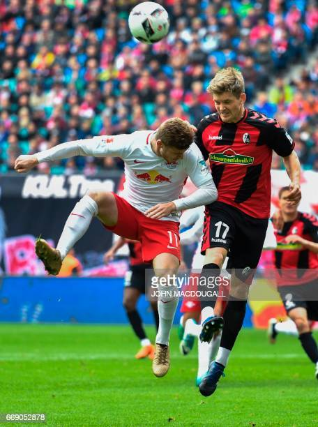 Leipzig's forward Timo Werner vies with Freiburg's defender Lukas Kuebler during the Bundesliga match RB Leipzig vs SC Freiburg in Leipzig on April...