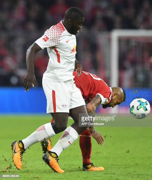 Leipzig's French defender Dayot Upamecano and Bayern Munich's Chilean midfielder Arturo Vidal vie for the ball during the German first division...
