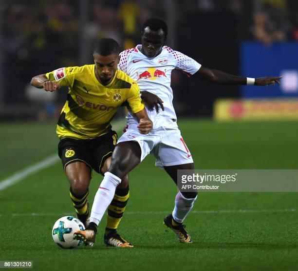Leipzig's French defender Dayot Upamecano and Dortmund's German defender Jeremy Toljan vie for the ball during the German first division Bundesliga...