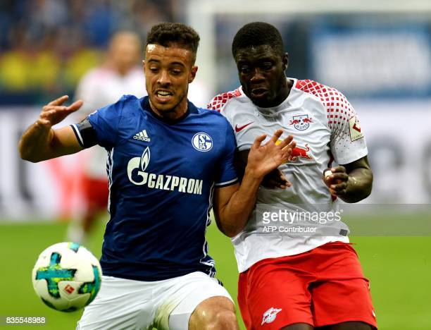 Leipzig's French defender Dayot Upamecano and Schalke's Argentinian forward Franco di Santo vie for the ball during the German First division...